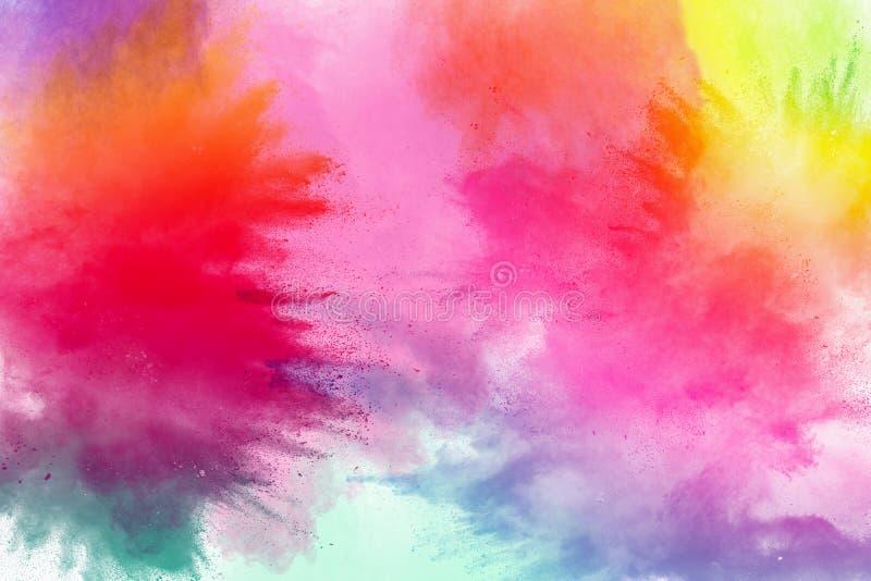 Congele o movimento das explosões coloridas do pó isoladas no fundo branco imagens de stock royalty free
