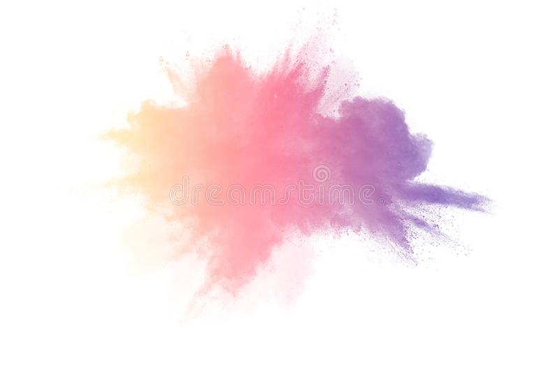 Congele o movimento das explosões coloridas do pó isoladas no fundo branco imagem de stock royalty free