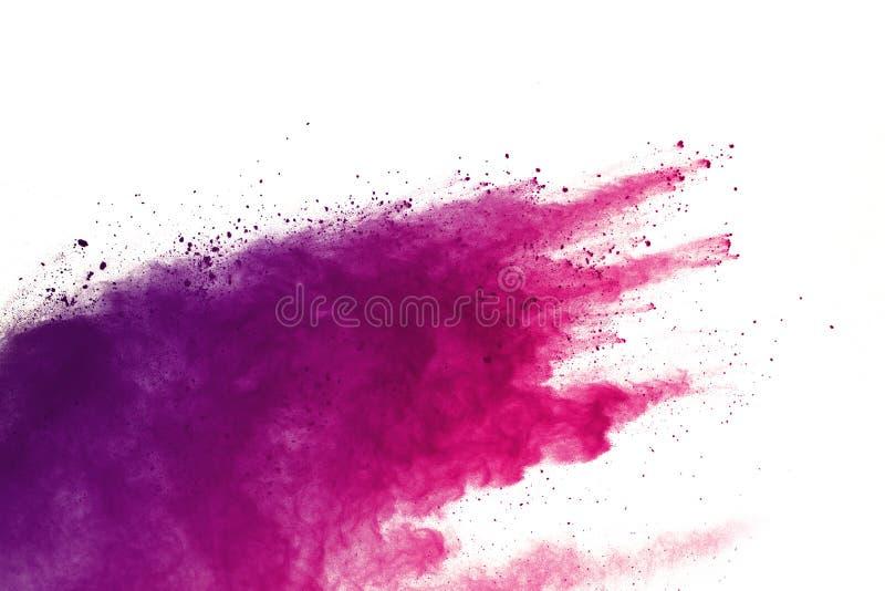 Congele o movimento das explosões coloridas do pó isoladas no fundo branco fotos de stock royalty free