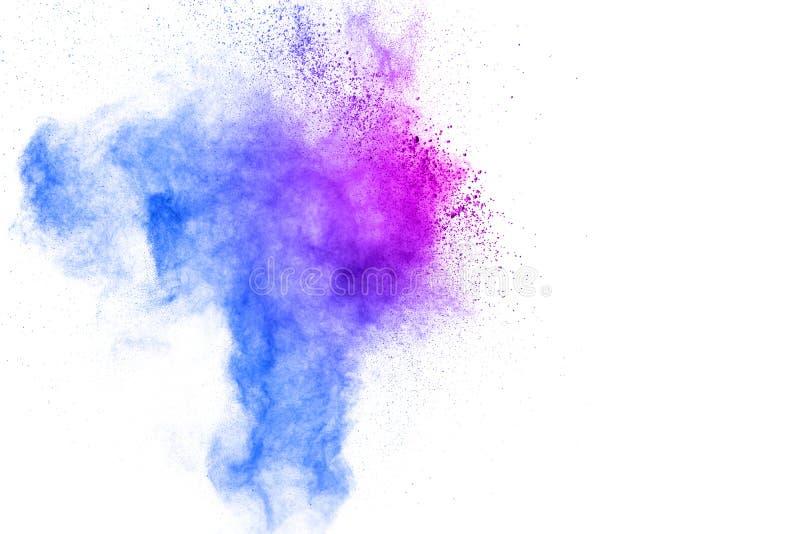 Congele o movimento das explosões coloridas do pó isoladas no fundo branco A partícula de poeira da cor salpicou o fundo imagens de stock