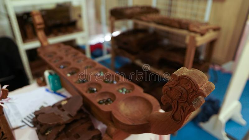 Congkak. A popular traditional games in Malaysia. Centuries of cultural diversity, heritage and tradition showcased in the form of exceptional quality crafts and stock photos