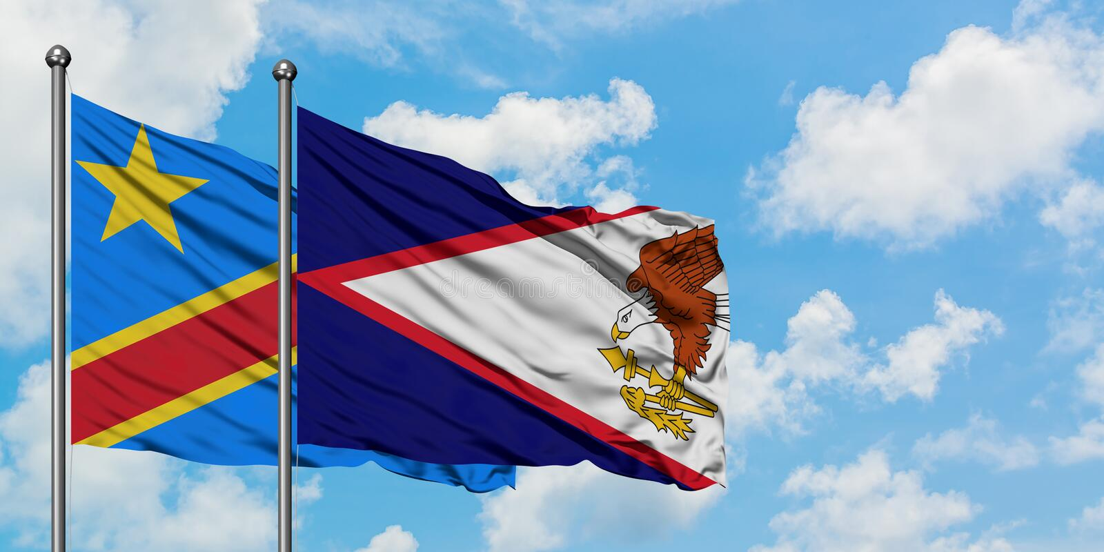 Congo and American Samoa flag waving in the wind against white cloudy blue sky together. Diplomacy concept, international. Relations, consul, diplomat stock photos
