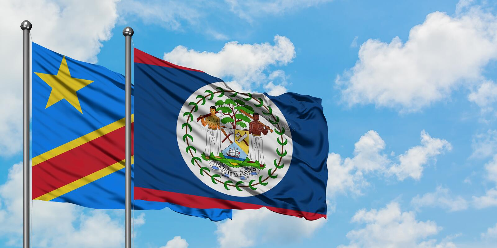 Congo and Belize flag waving in the wind against white cloudy blue sky together. Diplomacy concept, international relations. Consul, diplomat, ambassador royalty free stock image