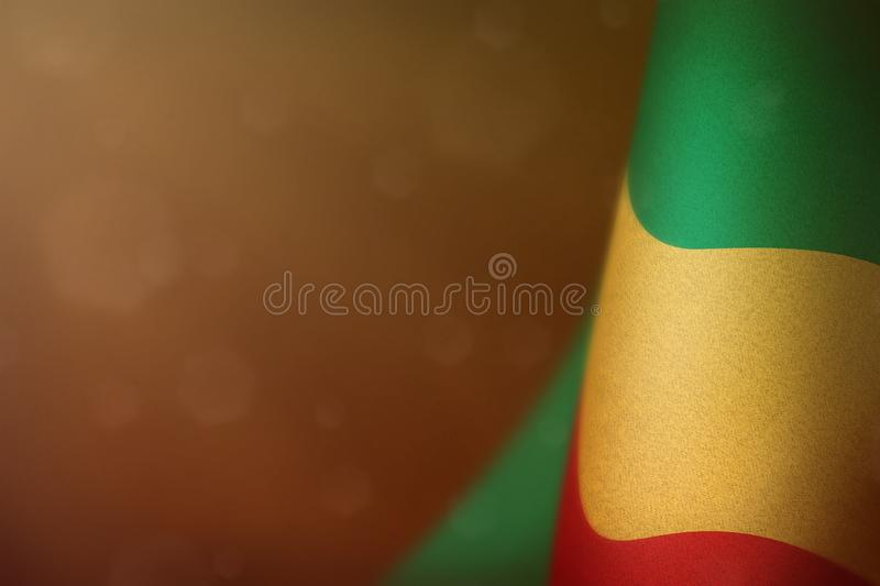 Congo flag for honour of veterans day or memorial day. Glory to the Congo heroes of war concept on orange dark velvet background. Congo hanging flag for honour stock illustration