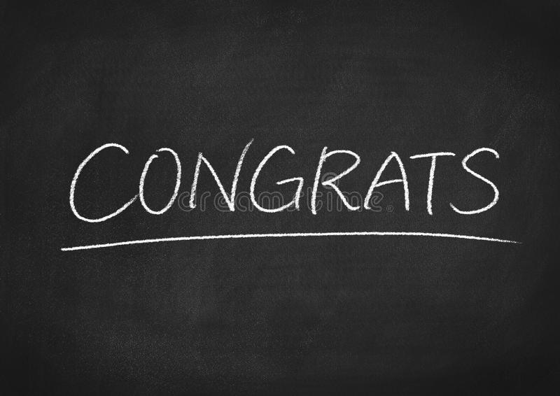 Congrats. Concept word on a blackboard background stock images