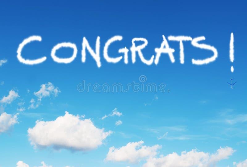 Congrats! skriftligt i himlen royaltyfri bild