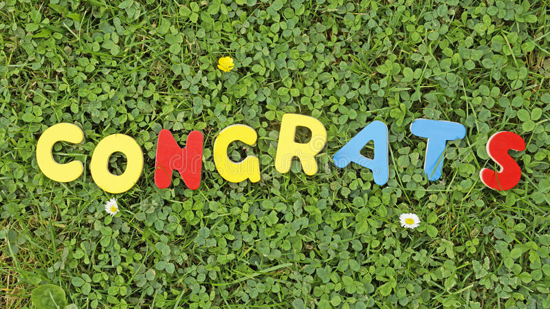 Congrats. Written with wooden letters in a sunny park stock photos