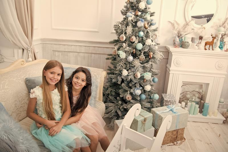 Congratulating her nearest. Happy new year. Winter. Christmas tree and presents. xmas online shopping. Family holiday. The morning before Xmas. Little girls royalty free stock image