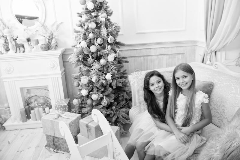 Congratulating her nearest. Happy new year. Winter. Christmas tree and presents. xmas online shopping. Family holiday. The morning before Xmas. Little girls royalty free stock photography