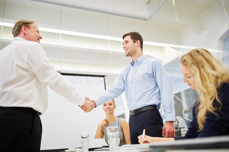 Congratulation with a hand shake. Between successful business people royalty free stock photos