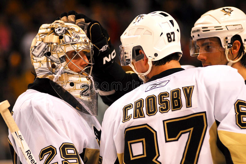Congratulations!. Sidney Crosby and another Pittsburgh Penguins player congratulate goalie Marc-Andre Fleury on another victory royalty free stock images
