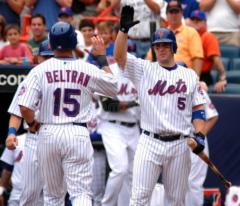 Congratulations!. New York Mets 3b David Wright congratulates teammate Carlos Beltran after hitting a homerun stock photo