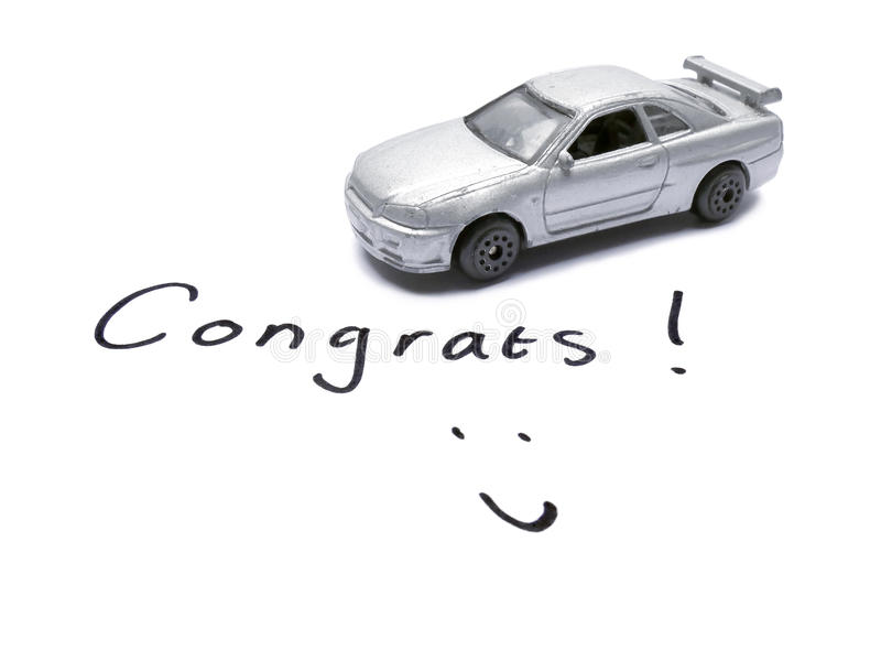 Congratulations Driver's License with old toy car model. In black and white royalty free stock photos