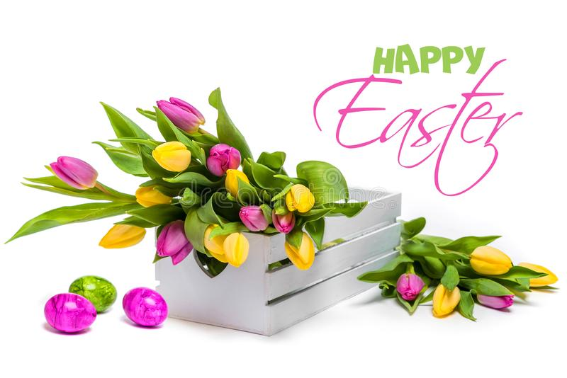 Congratulations on Easter. Still life of tulips and eggs stock photo