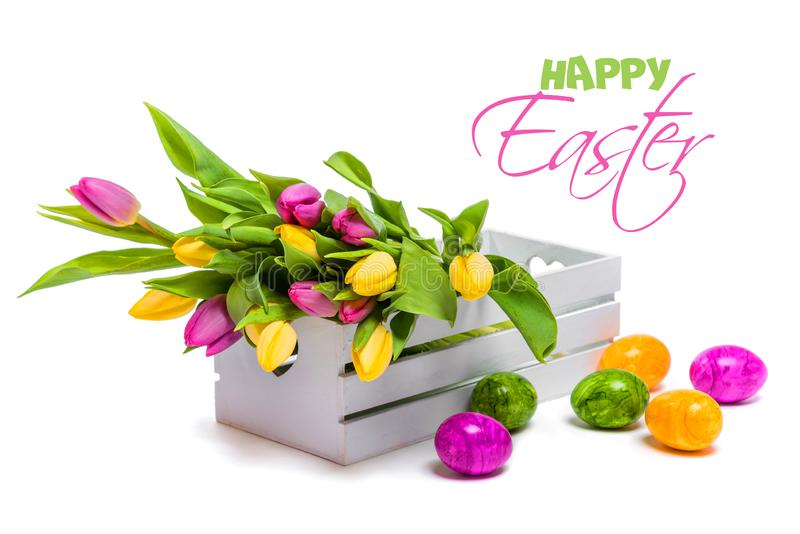 Congratulations on Easter. Still life of tulips and eggs royalty free stock image