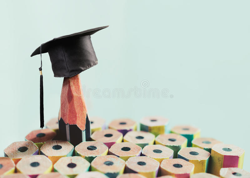 Congratulations graduates background, inscription in pencil and. Graduate cap royalty free stock images