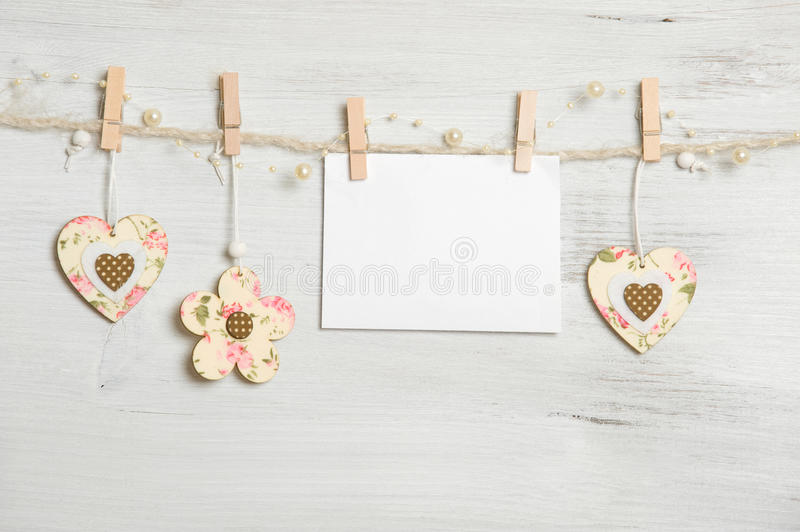 Congratulations. Heart, flowers and sign on clothesline on white wooden background stock photo
