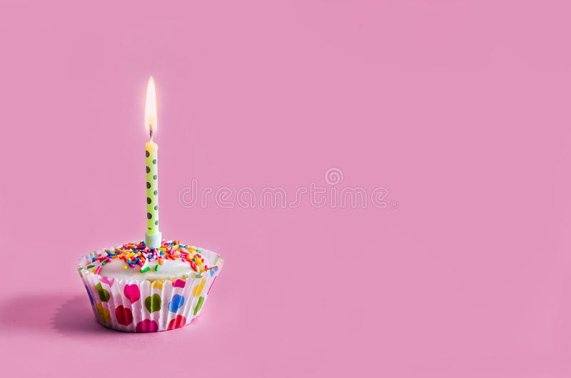 Congratulations. muffin, cupcake with a candle. birthday. Congratulations. muffin, cupcake with a candle. holiday birthday copy space, happy, card, party royalty free stock images