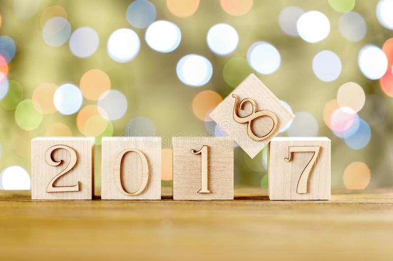 Congratulations to the New year. The new year 2018. Blurred light background. New year, replacing the old. stock photography
