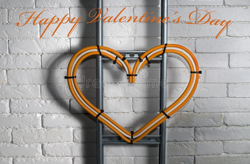 Congratulations on valentine`s day from electrician stock photo