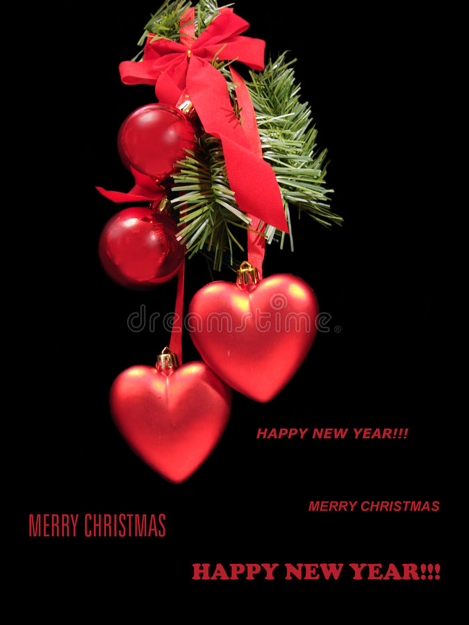 Congratulatory Christmas card with red balls and hearts on a fur. Tree?s branch stock photo
