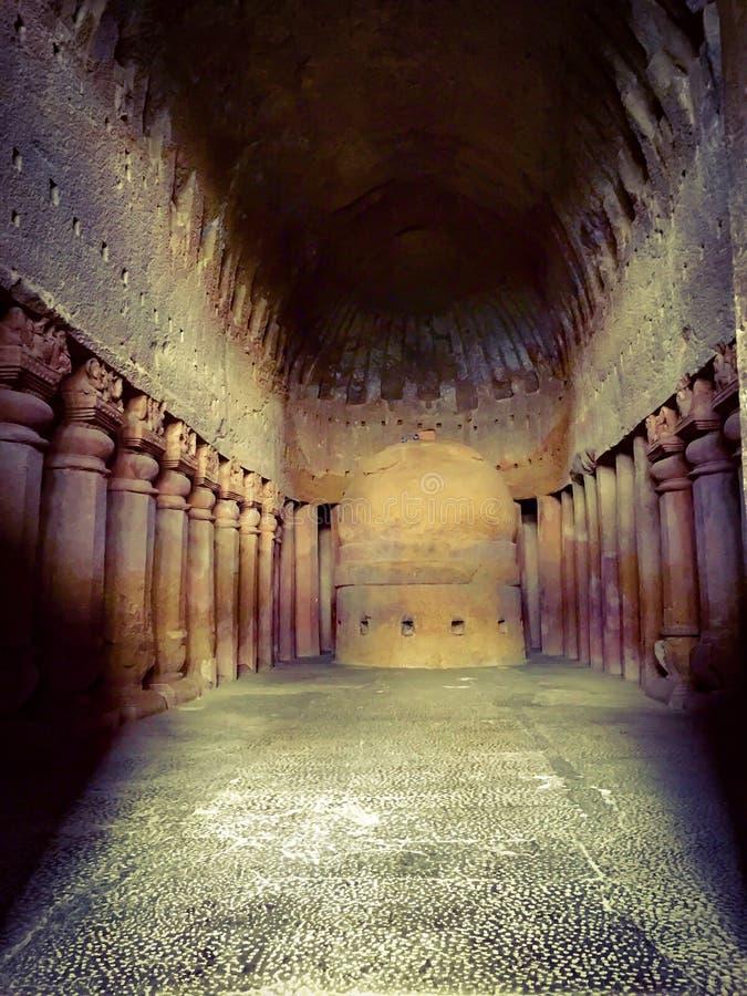 congregation hall with huge stone pillars and stupa in Kanheri Caves, Mumbai royalty free stock images