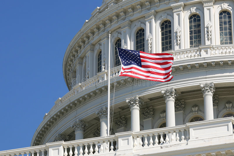 US Congress Capitol with Flag. Close-up of the Capitols dome with the US flag, Washington DC stock photo