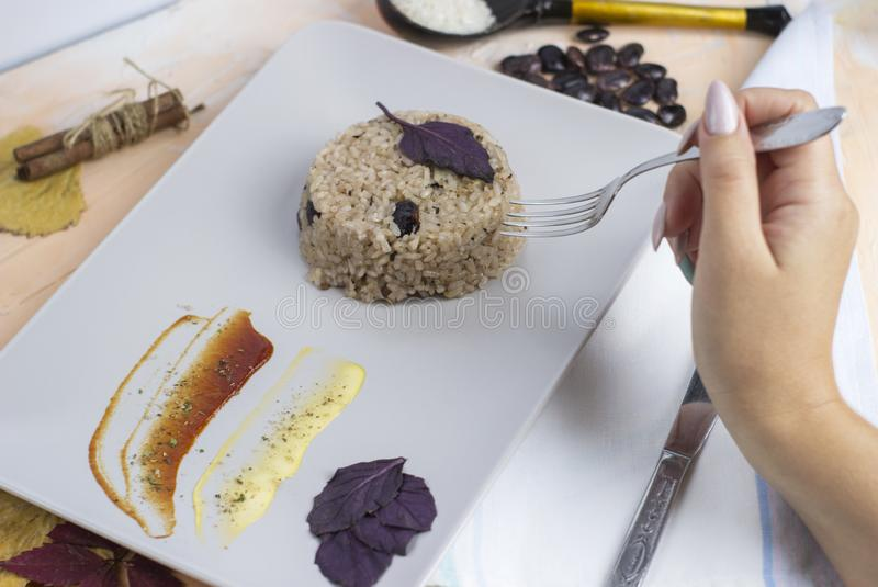 Congri dish of Cuban national cuisine. Congri, Rice with beans, a typical dish of Cuban food. Simple but delicious dish of rice. With fried beans and Congri royalty free stock photo