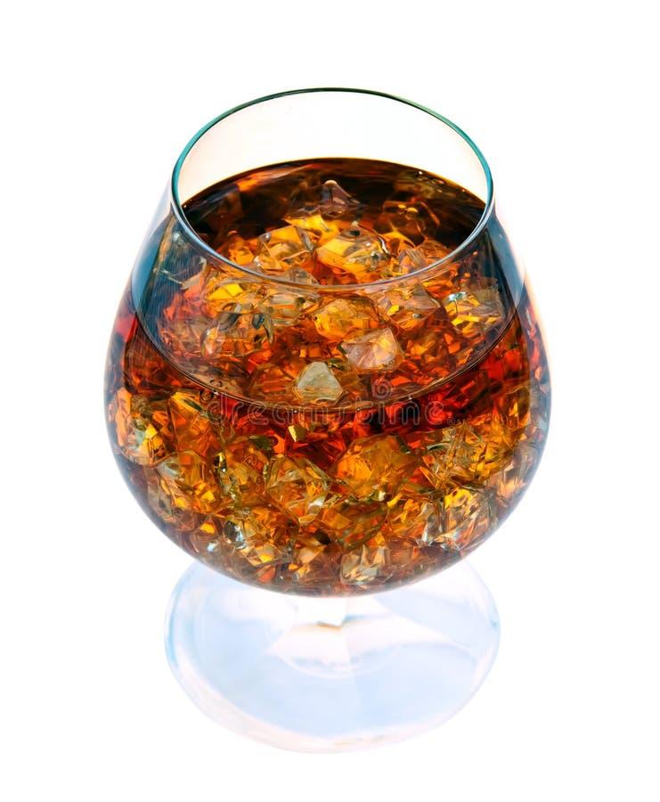 Conhaque com gelo em um vidro. fotografia de stock royalty free
