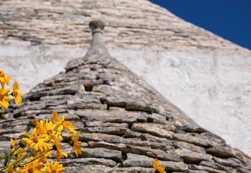 Conical roof of traditional trulli house in the Aia Piccola residential area of Alberobello in the Itria Valley, Puglia Italy. Conical roof of traditional dry royalty free stock image