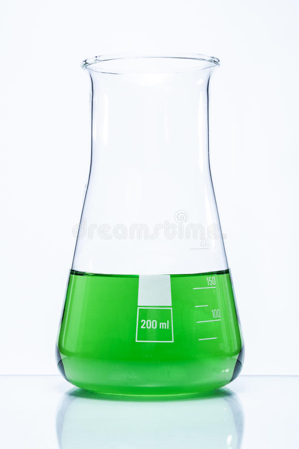 Conical temperature resistant flask with green liquid royalty free stock photos
