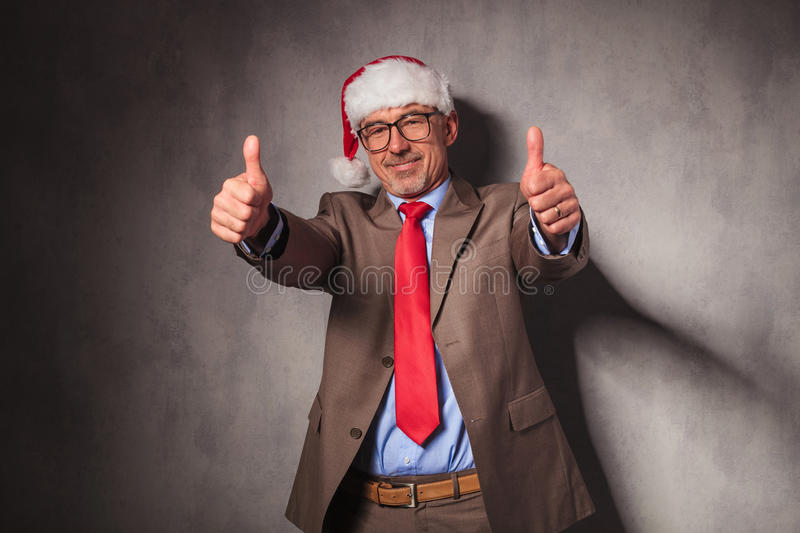 Conident santa claus business man making the ok sign royalty free stock photography