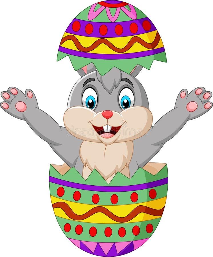 Coniglietto del fumetto uscito da un uovo di Pasqua illustrazione di stock
