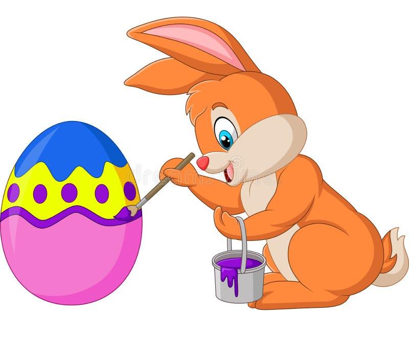 Coniglietto di pasqua che vernicia un uovo illustrazione vettoriale