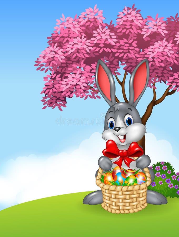 Coniglietto di pasqua del fumetto che giudica il canestro di Pasqua pieno delle uova di Pasqua decorate illustrazione di stock