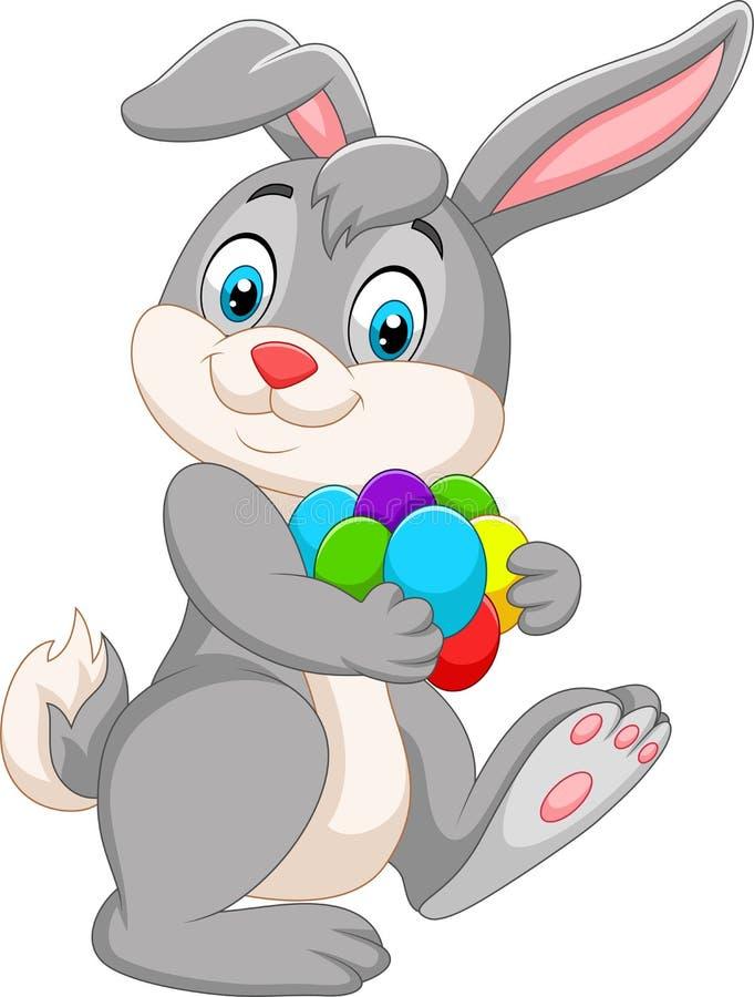Coniglietto di pasqua del fumetto che porta le uova variopinte illustrazione di stock