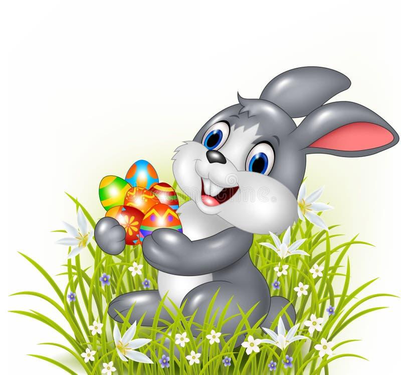 Coniglietto felice del fumetto che tiene un uovo di Pasqua royalty illustrazione gratis