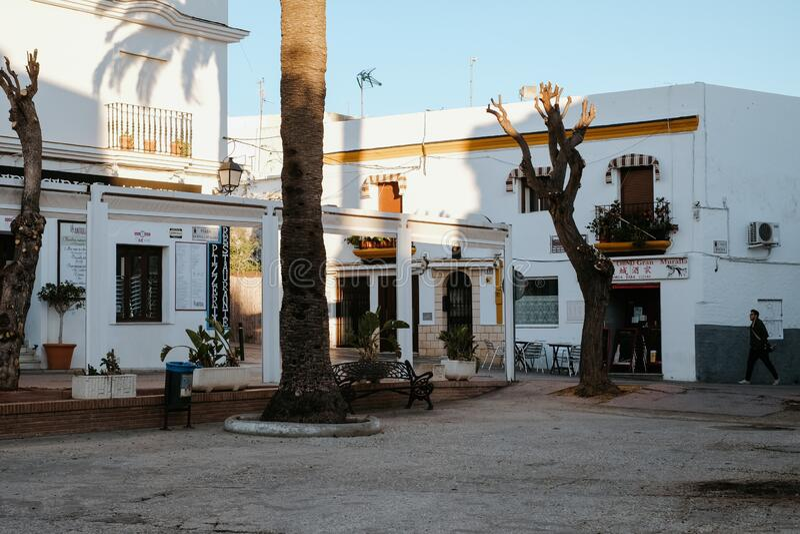 Square in Conil de la Frontera, white town in Costa de la Luz, Cadiz Province,. Conil de la Frontera, Spain - November 8, 2017: square in Conil de la Frontera stock photography