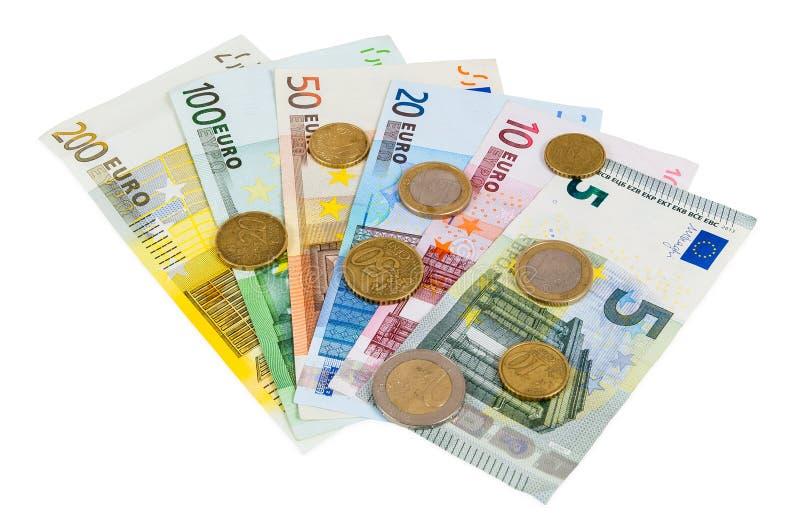 Conjunto de billetes de banco y de monedas euro imagenes de archivo