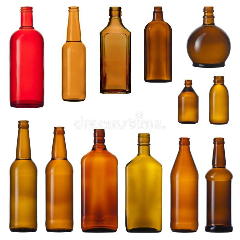 Conjunto de botellas de cristal marrones fotos de archivo