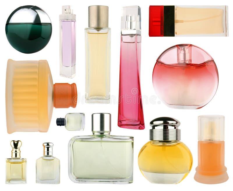 Conjunto de botellas de perfume aisladas en blanco fotos de archivo libres de regalías