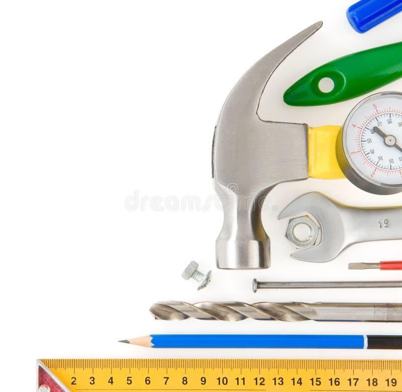 Conjunto de herramientas de la construcción en blanco foto de archivo libre de regalías