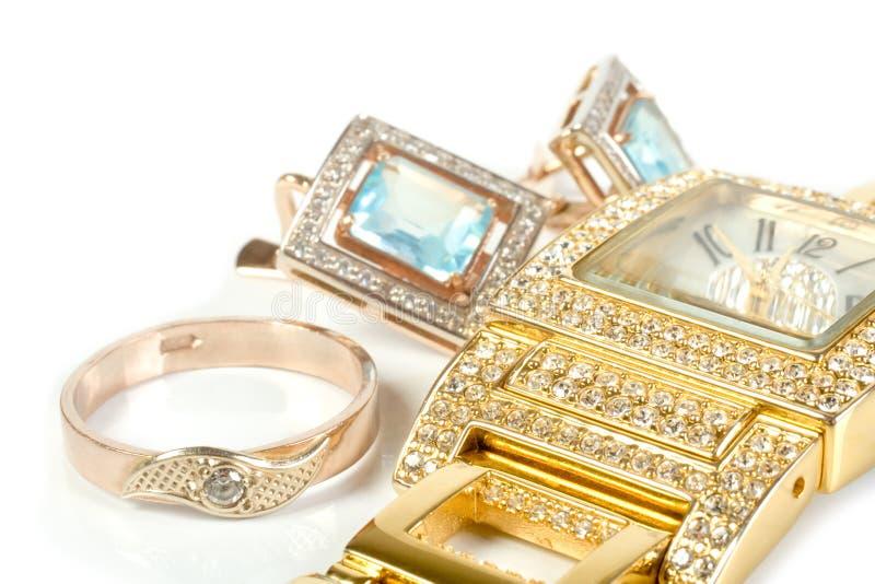 Conjunto de la joyería, anillo, reloj, pendientes foto de archivo