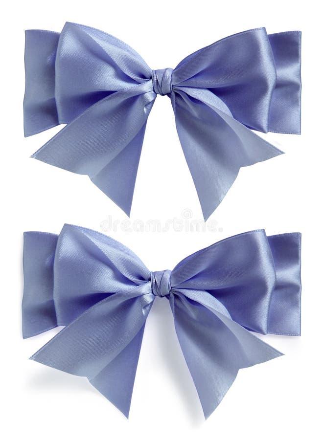 Conjunto de seda azul del arqueamiento fotografía de archivo
