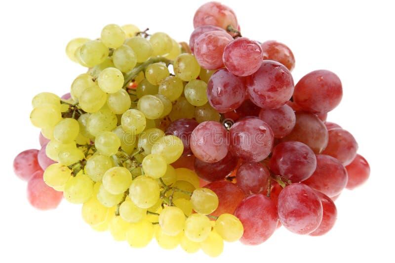 Conjuntos de uvas vermelhas e verdes imagens de stock royalty free