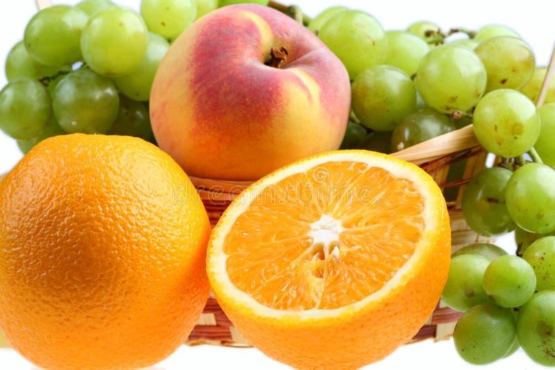 Conjuntos, pêssegos e laranja das uvas. fotos de stock royalty free