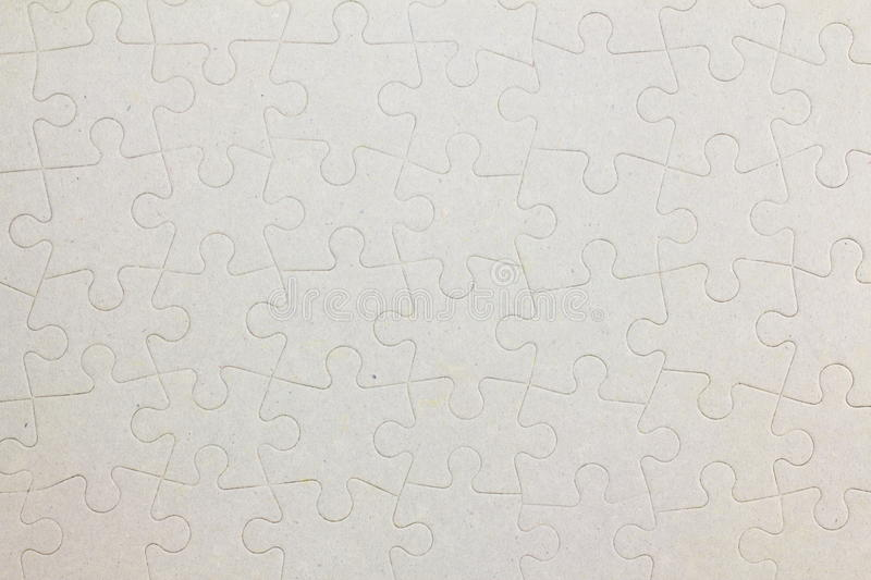 Connected blank jigsaw puzzle pieces as background royalty free stock photography