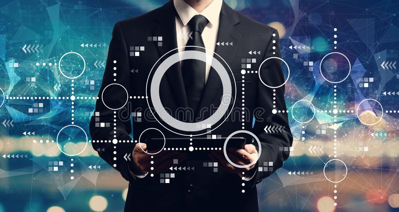 Connected circles chart with businessman holding a tablet stock photos