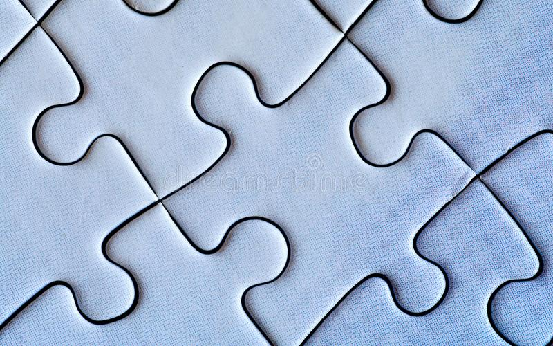 Connected pieces of puzzle. Closeup. stock photos