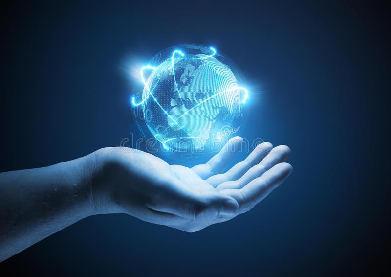 Connected World. Conceptual business illustration. A man holding a glowing projection of the world royalty free stock photography